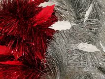 Christmas and New year decoration, red and silver tinsel. Background Stock Photography