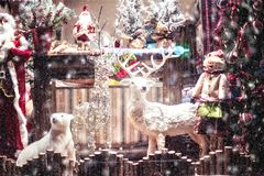 Christmas and New Year decoration store showcase. Tirana, Albania. November 12, 2017: Christmas holiday shop show-case window decoration with traditional Stock Photography