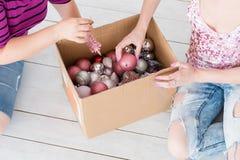 Christmas decor tradition women choose ball box royalty free stock photo