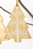 Christmas and New Year decoration, wood handmade fir tree made with white ornament hanging on a dry tree branch Stock Photo
