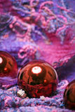 Christmas and New Year decorations. Red Christmas balls on the soft colorful material stock images