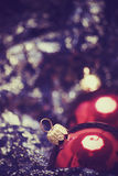 Christmas and New Year decorations. Red Christmas balls on the sheer black material royalty free stock image