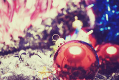 Christmas and New Year decorations. Different Christmas decorations on the sheer black material royalty free stock photography