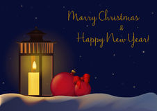 Christmas New Year Decorations background for greeting card with christmas balls and candle on the snow in night. Royalty Free Stock Images
