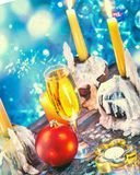 Christmas and new year decorations with champagne and candles stock photos