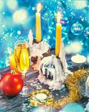 Christmas and new year decorations with champagne and candles stock image