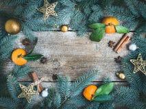 Christmas (New Year) Decorations: Fur-tree Branches, Golden Glass Balls, Golden Glittering Toy Stars, Fresh Mandarins, Cinnamon S Royalty Free Stock Photo