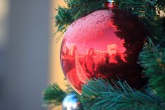 Christmas and new year decorations of houses and yard area. Christmas trees and trees are decorated with balls and toys. Festive. Mood is in air royalty free stock photography