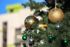 Christmas and new year decorations of houses and yard area. Christmas trees and trees are decorated with balls and toys. Festive. Mood is in air royalty free stock image