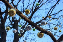 Christmas and new year decorations of houses and yard area. Christmas trees and trees are decorated with balls and toys. Festive. Mood is in air royalty free stock photo