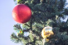 Christmas and new year decorations of houses and yard area. Christmas trees and trees are decorated with balls and toys. Festive. Mood is in air stock image