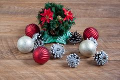 Christmas and New Year decorations are lying on a wooden desk. Stock Photos