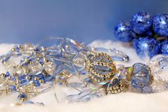Christmas and New Year decorative adornments. Blue, white and golden Christmas and New Year decorative adornments on a snow Royalty Free Stock Photo