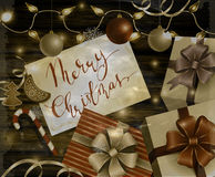 Christmas New Year design wooden background. Christmas New Year designt dark wooden background with silver and red balls and greeting card with handwritten Merry stock illustration