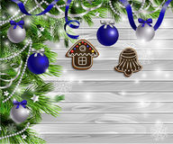 Christmas  New Year design wooden background. Christmas  New Year design light wooden background with christmas tree gingerbread decorations andblue silver balls Royalty Free Stock Photo