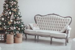 Christmas and New Year Eve Tree. Holiday winter background. Interior details - sofa, vintage gifts, candles. Isolated Stock Images