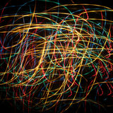 Christmas and New Year extravaganza lights. Abstract background with colored lights wandering ribbons in the dark stock photo