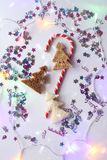 Christmas or New year festive background. Greeting card composition with striped candy, glitters and fir trees made of bread. Holi Royalty Free Stock Photos