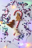 Christmas or New year festive background. Greeting card composition with striped candy, glitters and fir trees made of bread. Holi. Days concept stock images