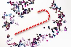 Christmas or New year festive background. Greeting card composition with striped candy and glitters. Holidays concept. Royalty Free Stock Photos