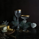 Christmas, new year. fir branches, cheese, Dor Blue and vintage champagne glasses. Royalty Free Stock Photo