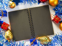 Christmas or New year flat composition. Black paper notebook with blank page. Royalty Free Stock Photography