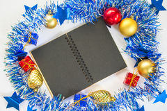 Christmas or New year flat composition with paper notebook and seasonal decor Stock Image