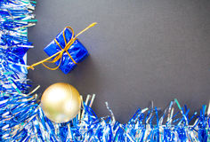 Christmas or New Year flat framed text place. Blue sparkling ribbon wreath. Gold ball and gift. Stock Photos