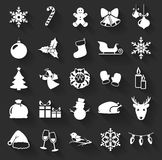 Christmas and New Year flat icons. Vector illustration. Christmas and New Year flat icons isolated on a dark background. Set of 25 white symbols with long Stock Illustration