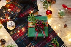 Christmas, New Year flat lay with Scottish tartan and lights on the wooden background. royalty free stock image