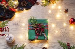 Christmas, New Year flat lay with Scottish tartan and lights on the wooden background. stock photo