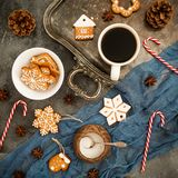 Christmas or New year food concept. Gingerbread, candy canes and coffee cup on dark background. Flat lay. Top view Stock Photo