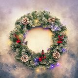 Christmas or New Year frame flat composition with green snow fir. Branches in wreath, pine cones, golden snowflakes, Christmas balls, red berries on gray stock photos