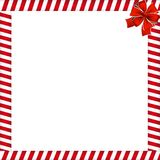 Christmas or new year frame with red and white lollipop pattern and red festive bow. Christmas or new year frame with red and white lollipop pattern and red Stock Photo
