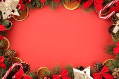 Christmas and New Year frame for text with a Christmas tree and colored Christmas decorations on a red bright background. view fro. M above stock photo