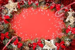 Christmas and New Year frame for text with a Christmas tree and colored Christmas decorations on a red bright background. view fro. M above stock images