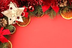 Christmas and New Year frame for text with a Christmas tree and colored Christmas decorations on a red bright background. view fro. M above royalty free stock image