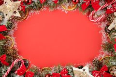 Christmas and New Year frame for text with a Christmas tree and colored Christmas decorations on a red bright background. view fro. M above stock image
