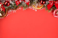 Christmas and New Year frame for text with a Christmas tree and colored Christmas decorations on a red bright background. view fro. M above royalty free stock photos