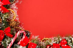 Christmas and New Year frame for text with a Christmas tree and colored Christmas decorations on a red bright background. view fro. M above royalty free stock images