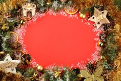 Christmas and New Year frame for text with a Christmas tree and colored Christmas decorations on a red bright background. view fro. M above royalty free stock photography