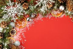 Christmas and New Year frame for text with a Christmas tree and colored Christmas decorations on a red bright background. view fro. M above stock photos
