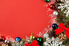 Christmas and New Year frame for text with a Christmas tree and colored Christmas decorations on a red bright background. view fro. M above royalty free stock photo