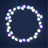 Christmas and New Year Garland Light Design on Blue Background. Holiday lights. Vector illustration Stock Photos