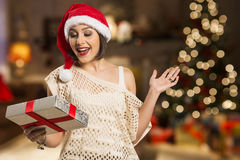 Christmas or New Year Gift. Surprised Woman over christmas backg Stock Photos