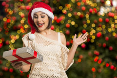 Christmas or New Year Gift. Surprised Woman over christmas backg Stock Images