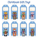 Christmas and New Year gift tags with animals holding presents Royalty Free Stock Image
