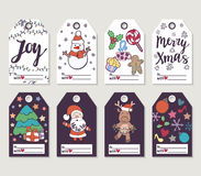 Christmas and New Year gift tags and cards. Hand drawn doodle design elements and calligraphy. Handwritten modern lettering Stock Photography
