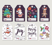 Christmas and New Year gift tags and cards. Hand drawn doodle design elements and calligraphy. Handwritten modern lettering Royalty Free Stock Images
