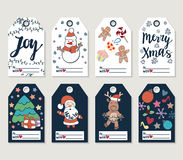 Christmas and New Year gift tags and cards. Hand drawn doodle design elements and calligraphy. Handwritten modern lettering Stock Photos